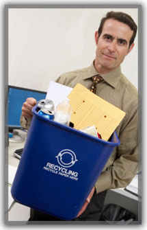 Man carrying recycle basket in office.